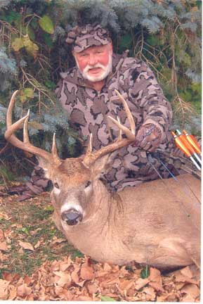 "Bob Fratzke from Winona Mn hunting in Mn on Oct 31, 2011.  The deer has an 18"" inside spread and 8 points.  Bob always hunts in his Winona Camo hunting clothes"