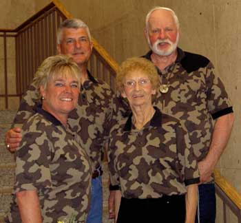 Bob and Betty Fratzke stand up for Scott and Lori Smolen at their wedding, all dressed in Fratzke Camo Wear