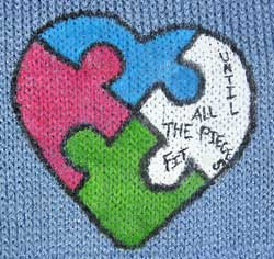 Autism Awareness heart puzzle with missing piece knit on a scarf